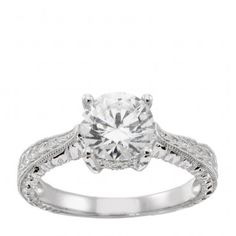 1.67 carat round brilliant cut center stone. This would make a beautiful right hand ring...and 6 year wedding anniversary gift. Just sayin'.