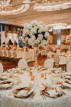 Ivory large centerpieces with dark red pops of color.Luxury wedding at the Mandarin Oriental with a color scheme of white, blush, and pops of wine red produced by Las Vegas Wedding Planner Andrea Eppolito with photos by Stephen Salazar Photography.  http://www.andreaeppolitoevents.com