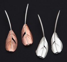 Cock feather earrings, copper with sterling or sterling. Copyright Robyn Nichols