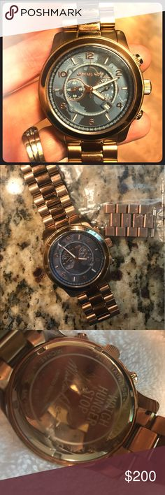 Michael Kors Watch Stop Hunger Limited Edition Beautiful, bold, authentic limited edition MK watch in gold. Men's size, but the links were removed to fit a woman's wrist. I have the links though so it could be for a man or woman. This watch is definitely a statement piece. Very mild scratching, but overall in great condition. Last picture shows men's and women's watch for size reference. Michael Kors Accessories Watches