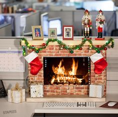 Looking for festive office decoration tips? Staples has more this holiday. Try this DIY Merry Monitor Fireplace idea with cardboard boxes and craft paper.
