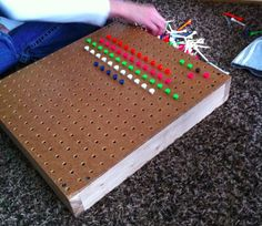 Coolest toy: a pegboard screwed on to a wooden frame and a bunch of colorful golf tees. How creative!