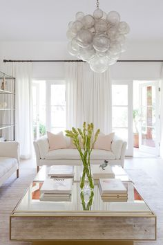 A Striking Contemporary Home in Santa Monica | Interior Design by Lucie Ayres of 22 Interiors | Photography by Amy Bartlam | Modern Sanctuary | Living Room | Glamorous Living Room | Bohemian Living Room | White Living Room | Lighting | Window Treatment | Seating