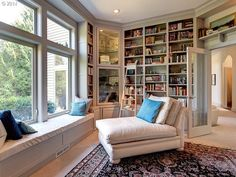 Traditional Library with Bookshelf ladder, Window seat, French doors, Built-in bookshelf, Crown molding, Carpet