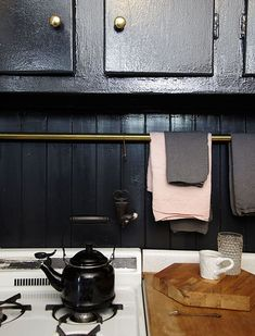 this one rod across the backsplash is genius. going to do this.  small space east village flat via lonny / sfgirlbybay