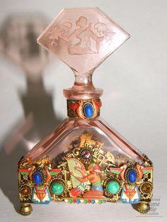 Egyptian Jeweled Bottle  Specialty:Czechoslovakian    Material(s):Pink crystal, enameled metal, opaque glass jewels    Designer/Maker:Franz Josef Vater    Date or Era:1925-38