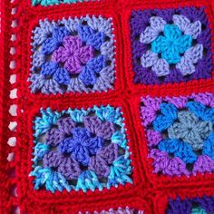 This afghan contains 20 of my favourite shades of lilac, lavender, mauve, amethyst, purple, lavender blue, royal blue, aqua, seafoam, light teal, dark teal, and celadon. Theres even a purple ombre and a blue ombre. Each square and then the entire afghan is bordered in scarlet red. Finished afghan measures approx. 46 in. x 55 in. (117 cm x 140 cm) and is made with soft 100% acrylic yarn. It is machine washable and dryable on gentle cycle.  This afghan is made-to-order. Please see my shop…