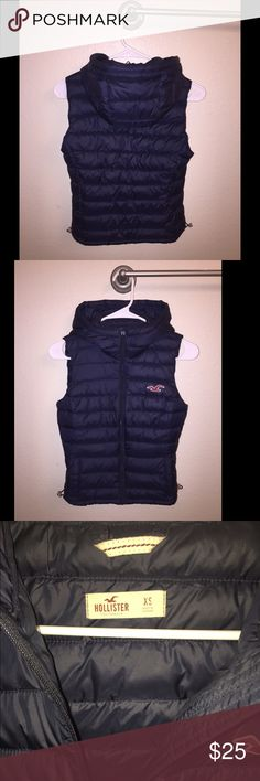 Dark blue puffer vest Warm Zipper puffer vest great for layering has a hood and adjustable sides Hollister Jackets & Coats Vests