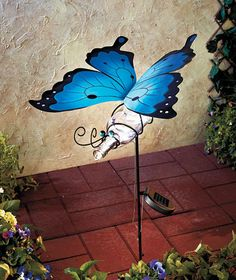 Solar Butterfly Wine Bottle Stake- would be pretty in the side yard but don't know if it would get enought light during the day