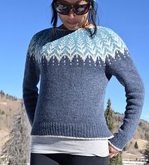 """Vintersol (""""winter sunshine"""") is inspired by a walk in a frosty, wintery meadow. This example is made with a soft and wooly double strand of Camilla Vad yarn, which creates a lofty worsted weight that is warm yet lightweight. This design lends itself well to a variety of color combinations. Choose 3 colors of yarn or simplify and go with two. You can even fade the background of the yoke, creating a gradient, while using a light color for the motif."""