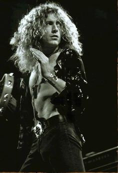 Robert Plant -- I don't know what it is about him & Jimmy Page, maybe because they're musical geniuses, but I'm in love.