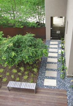 Pebbles mulch and wood in an outdoor space Lawn Alternatives for the Modern Yard