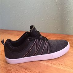 NWT grey sneakers with black trim Soft stretchy fabric fits low profile. New in box. Shoes Sneakers
