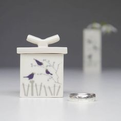 If you want your ring box to serve as a decorative item that you can carry on using at home, then take a look at this pretty porcelain box from Sue Candy Ceramics