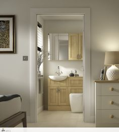 This compact en suite bathrooms offers great storage with the fitted furniture and vanity unit. The Oak Shaker doors are classic in design and sit well with natural styling and textures. CGI inspiration by http://www.setvisionspix.co.uk/