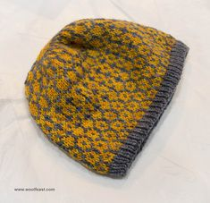 A stranded colour work beanie, with simple repeats, creating an all over low-contrast design.
