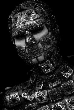 Alexander McQueen~~~~~Maybe have it made of silver and used on bad little vamps or weres.