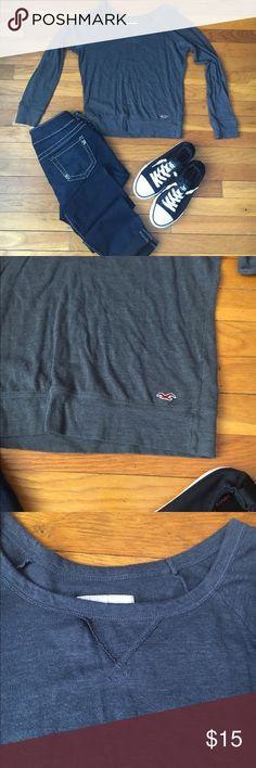 Dark gray hollister top, long sleeve In great condition dark gray long sleeve tee shirt size xs Hollister Tops Tees - Long Sleeve
