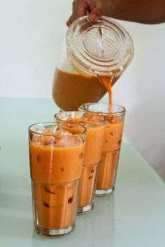 Thai iced tea is rich and milky, with an earthy orange color. Thai people brew strong black tea in a cotton tea sock, mix it with ice, sugar, and sweetened condensed milk, and pour it over ice. Thai tea is usually black tea mixed with anise or licorice flavoring, and traditionally colored with tamarind though orange food coloring is more common these days.