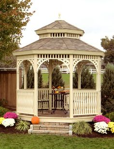 Very country and pretty. I really like the idea of backing/surrounding a gazebo with trees like the ones in this photo. -Garden Gazebo Ideas-