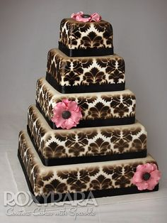 www.RoxyRara.com  Paisley black and white five tier wedding cake with handmade sugar flowers.   To book in for a tasting or consultation, email: cake@roxyrara.com