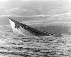 Royal Navy frigate HMS Antelope going under after being hit by Argentinian bombs.
