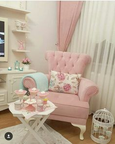 Shabby Chic Pink Stuffed Chair, Small White Table and Bird Cage with Pink Floral Accents