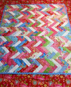 "Make your own ""Pip Studio"" Scrap Quilt from Jelly Rolls. Instructions: http://www.quiltshop-online.nl/over-quilten/gratis-patronen"