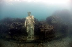 Underwater Roman ruins off the coast of Naples, Italy.  Sounds like a good scuba opportunity.