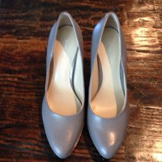 NWT NINE WEST PUMPS Brand-new never worn gray leather pumps. Great for work. Heel measures 4 inches. Nine West Shoes Heels