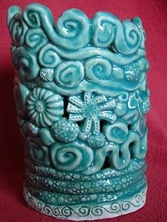 coil pot.... done this with bowls before, but these arelovely!!!!  I love the pressed images into them as well!