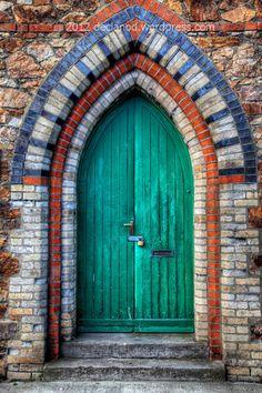 Green Door Polychrome brickwork doorway on Howth Pier, County Dublin, Ireland.