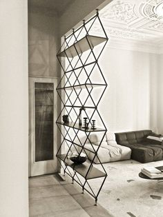 Room dividers don't need to be boring! This Criss-Cross Wire Shelf provides storage space for relaxed music room