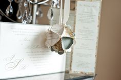 Ornament made by your wedding invitation - I will be getting one of these!