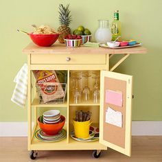 Portable Party Cart- This rolling cart makes a super functional party station. Store party dishes, silverware and glasses on the shelves so guests can easily help themselves. Tack fun recipes for drink mixers on the corkboard door to keep them handy. Place the food and drinks on top, and let the mingling begin.