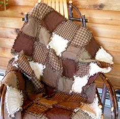 Love the colors in this one....I have made many of these home spun rag quilts!!!    Google Image Result for http://www.oldcountrycrows.com/images/BrownThrow.jpg