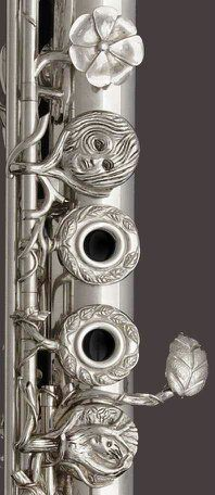 FLUTE with engravings (carvings) onto keys,   around soundholes.  RESEARCH via DdO:)  http://www.pinterest.com/DianaDeeOsborne/instruments-for-joy - John Lunn's THE DRYAD'S KISS 2012 won 2013 award. Most professional flautists (flutists) use flutes entirely of silver, which provides warm, rich tone with clean crisp response. One of most expensive materials is platinum. Student flutes usually of Nickel silver- durable  more resistant to denting than silver, yet still producing nice tones.