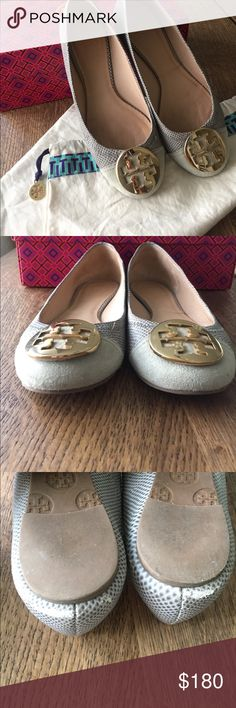 Tory Burch gray suede and snakeskin flats size 6 Preloved gray flats with suede toe area and snakeskin sides that show wear on leather near heels (see picture) and other areas (see pictures). Medallion is gold in color. Comfortable but feel a little small on me. Comes with dust bag and shoebox. Tory Burch Shoes Flats & Loafers