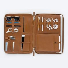 """The 13"""" MacBook Pro or Air Mod Laptop holder uses signature toffee primo leather. The inside pockets and slots were designed to hold all your creative gear as the perfect mobile office. The case's leather will age & mold nicely based on what and how you carry"""