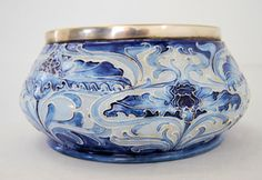 William Moorcroft Pottery, Florain Ware art nouveau pottery bowl with silver plate top.