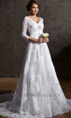 This dress meets all of the criteria for my perfect wedding dress: empire waist, sleeves, intricate detailing...I hope I can find something like this!