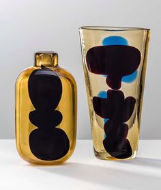 FULVIO BIANCONI, A Macchie, bottle and vase, 1950. Material amber glass with colored a macchie inclusions. Manufactured by Venini, Italy. / Daily Apple #amacchie #fulviobianconi #murano #venini #glass #glassart #art #modernart #abstractart #midcenturymodern #MCM #italiandesign #scandinaviancollectors #italianmodern #bottle #vase #amber #macchie