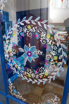Flower wreath on the front door. The wreath was made with wipeable chalk markers ., Chalk is this kind of fun method to be creative!