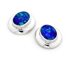 An epitome of class, this pair of stud earrings showcases the beauty of Natural Austarlian Opal in its finest.   Featuring two stunning oval shape Light Opal Doublets sourced directly from opal mines in Coober Pedy, South Australia, the sleek 14k White Gold does without excess detailings that would detract from the pure beauty of the colourful opals.  Perfect for everyday wear, it is a must have in any quality jewellery collection! #opalsaustralia
