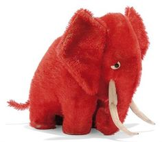 A STEIFF RED MOHAIR ELEPHANT (MAMMOTH), (7122), standing, black boot button eyes, white felt crescents behind, white felt tusks, red felt pads and FF button, circa 1912 --8¼in. (21cm.) high (some thinning and slight fading)