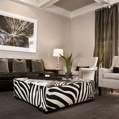 HGTV - living rooms - gray, green, brown, white, black, zebra, square, ottoman, ivory, upholstered, chairs, brown, velvet, lumbar, pillows, brown, leather, sofa, green, velvet, throw pillows, brown, rug, glass, lamp, abstract, art, gray walls, gray paint, gray paint colors,