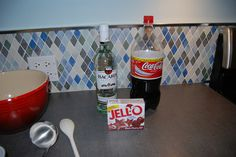 rum and coke jello shot - boil 2 cups coke, mix with black cherry jello for 2 minutes and add 2 cups rum