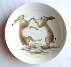 Hand painted bowl, boxing hares painting, lustre overglaze enamels on porcelain. £80.00, via Etsy.
