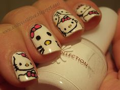 combining two of my favourite things in the world, nail art and hello kitty...hehe...not a huge fan of fake or large nails...so love these hand painted kitties!!