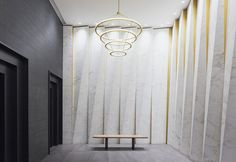 Pleated calacatta marble and bronze-tinted aluminum | Fashion Tower – GRT Architects